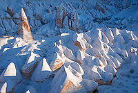 Goreme, Nevsehir, Cappadocia, Turkey. Hot air Balloons fly over the valleys of Cappadocia. A fresh pack of snow has turned the winter landscape of Goreme National Park into an even bigger fairy tale. Photo by Frits Meyst / MeystPhoto.com