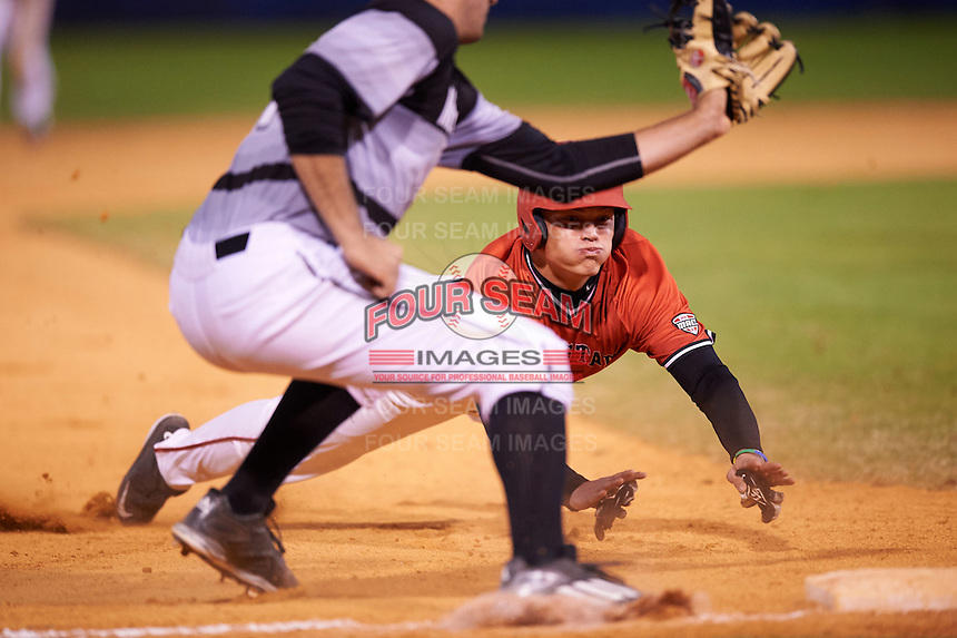 Ball State Cardinals right fielder Alex Call (8) slides head first into third as third baseman Nick Unes waits for a throw during a game against the Wisconsin-Milwaukee Panthers on February 26, 2016 at Chain of Lakes Stadium in Winter Haven, Florida.  Ball State defeated Wisconsin-Milwaukee 11-5.  (Mike Janes/Four Seam Images)