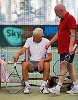 Hilversum, The Netherlands, 05.03.2014. NOVK ,National Indoor Veterans Championships of 2014, changeover with Bert Bos (NED) and Huug van Wingerden (NED)(L)<br /> Photo:Tennisimages/Henk Koster