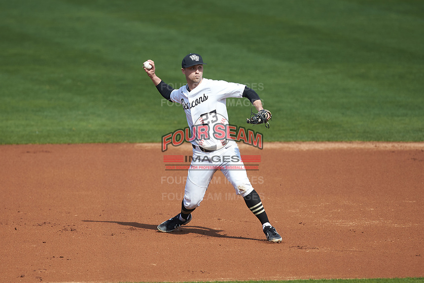Wake Forest Demon Deacons third baseman Jake Mueller (23) makes a throw to first base against the Furman Paladins at BB&T BallPark on March 2, 2019 in Charlotte, North Carolina. The Demon Deacons defeated the Paladins 13-7. (Brian Westerholt/Four Seam Images)