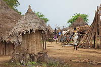 Ethiopia. Southern Nations, Nationalities, and Peoples' Region. Omo Valley. Korcho Village. Kara tribe. Agro-pastoralist group. Two men walking among huts and granary. The Omo Valley, situated in Africa's Great Rift Valley, is home to an estimated 200,000 indigenous peoples who have lived there for millennia. Amongst them are 1,000 to 2,000 Karo who dwell on the eastern banks of the Omo river. Southern Nations, Nationalities, and Peoples' Region (often abbreviated as SNNPR) is one of the nine ethnic divisions of Ethiopia. 8.11.15 © 2015 Didier Ruef