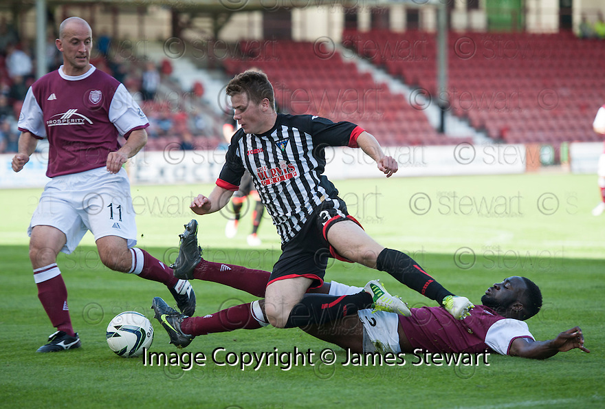 Arbroath's David Banjo make a challenge on  and Pars' Alex Whittle.