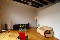 The sitting area is located at the far end of the open-plan loft space