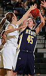 JANUARY 30, 2015 -- Sarah Seefeldt #45 of Regis University tries to shoot over Taylor Trohkimoinen #11 of Black Hills State during their Rocky Mountain Athletic Conference women's basketball game Friday evening at the Donald E. Young Center in Spearfish, S.D.  (Photo by Dick Carlson/Inertia)