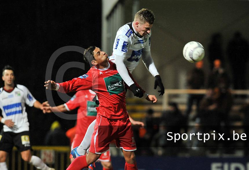 KSV Roeselare - R. Antwerp FC : Jordan Faucher in een kopduel met Sebastien Dewaest (rechts).foto VDB / BART VANDENBROUCKE
