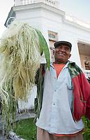 A man carying Heneken. Merida, Yucatan, Mexico