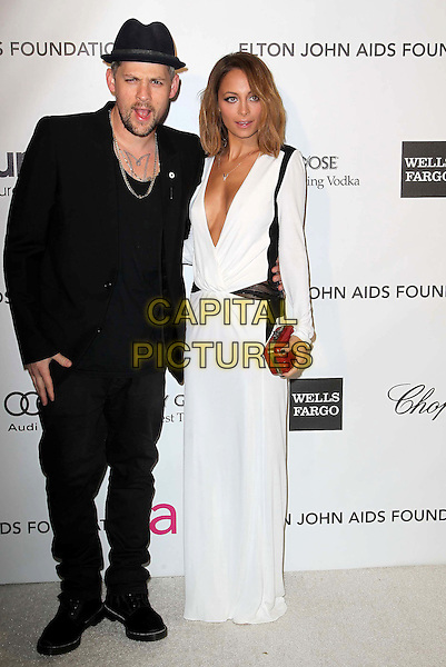 Joel Madden and Nicole Richie.The 21st Annual Elton John AIDS Foundation Academy Awards Viewing Party held at The City of West Hollywood Park in West Hollywood, California, USA..February 24th, 2013.oscars full length black suit hat beard facial hair white dress long sleeves plunging neckline cleavage red clutch bag married husband wife mouth open.CAP/ADM/KB.©Kevan Brooks/AdMedia/Capital Pictures.