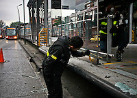 Transmilenio workers fix and clean a bus station after protest for the high cost of unit ticket in Bogota, Colombia. 15/03/2012.  Photo by Nestor Silva / VIEWpress.
