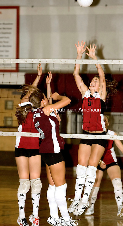 TORRINGTON, CT-17 OCTOBER 2006-101706JS03-Torrington's Cayce Jacob, left and Brooke Johnson, right, try to block a shot by Naugatuck's Ashley Barbieri during their game Tuesday at Torrington High School. <br />  -Jim Shannon Republican-American
