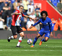 Chelsea's Willian (right) battles with Southampton's Oriol Romeu (left) <br /> <br /> Photographer David Horton/CameraSport<br /> <br /> The Premier League - Southampton v Chelsea - Saturday 14th April2018 - St Mary's Stadium - Southampton<br /> <br /> World Copyright &copy; 2018 CameraSport. All rights reserved. 43 Linden Ave. Countesthorpe. Leicester. England. LE8 5PG - Tel: +44 (0) 116 277 4147 - admin@camerasport.com - www.camerasport.com