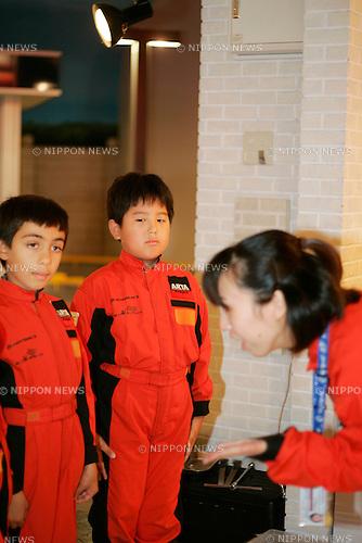 """KIDZANIA TOKYO, """"Edutainment City"""",.children receiving mechanic training at Autobacs."""