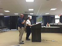 NWA DEMOCRAT-GAZETTE/TRACY M. NEAL Rogers Fire Chief Tom Jenkins and Police Chief Hayes Minor attended the city council meeting Tuesday, Aug. 8, 2017. They were in favor of changing the names of two roads.