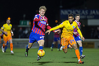Joe Worrall of Dagenham & Redbridge & Paris Cowan-Hall of Wycombe Wanderers battle for the ball during the Sky Bet League 2 match between Dagenham and Redbridge and Wycombe Wanderers at the London Borough of Barking and Dagenham Stadium, London, England on 9 February 2016. Photo by Andy Rowland.