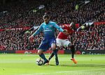 Henrikh Mkhitaryan of Arsenal tackled by Ashley Young of Manchester United during the premier league match at the Old Trafford Stadium, Manchester. Picture date 29th April 2018. Picture credit should read: Simon Bellis/Sportimage