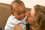 9 month old baby boy happy interaction with mother,  adopted from Ethiopia