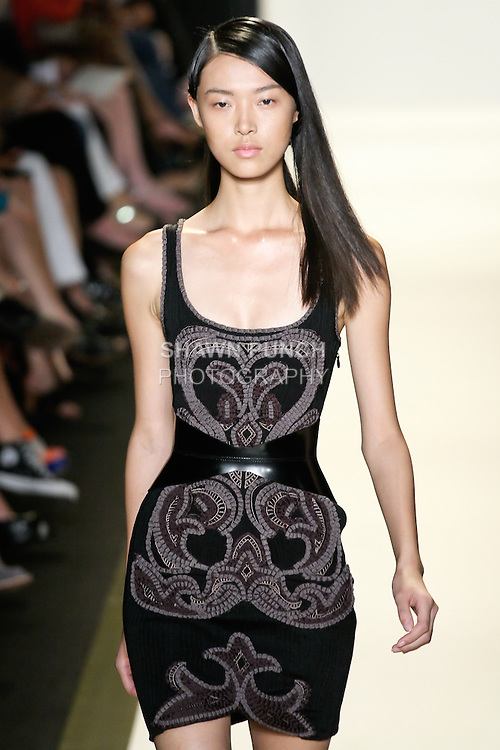 Tian walks runway in an outfit from the Hervé Léger by Max Azria Spring 2013 collection during Mercedes-Benz Fashion Week, in New York, September 8, 2012.