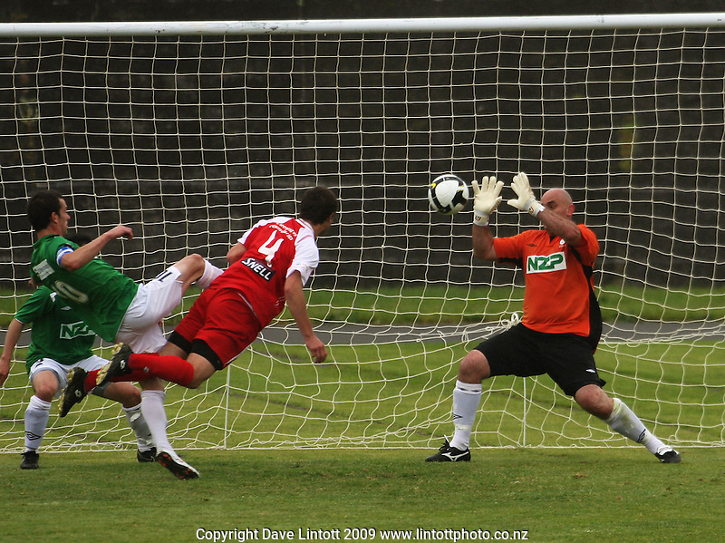 Manawatu keeper Ross Nicholson blocks a shot by Timothy Myers..NZFC Championship soccer - Youngheart Manawatu v Waitakere United at Memorial Park, Palmerston North. Sunday, 15 November 2009. Photo: Dave Lintott/lintottphoto.co.nz