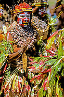 Papua New Guinea, Western Highlands Province, Mt. Hagen Cultural Show, woman dancing while hitting drum