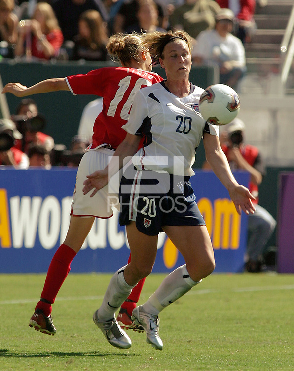 Abby Wambach, USA vs. Canada at the Third Place Match of the FIFA Women's World Cup USA 2003. USA 3, Canada, 1. (October 11, 2003). .