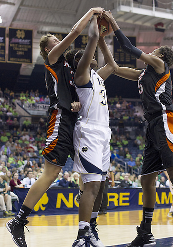 November 20, 2012:  Notre Dame forward Markisha Wright (34) along with Mercer forwards Sharmesia Smith (right) and Kate Alemann (left) battle for the rebound during NCAA Women's Basketball game action between the Notre Dame Fighting Irish and the Mercer Bears at Purcell Pavilion at the Joyce Center in South Bend, Indiana.  Notre Dame defeated Mercer 93-36.