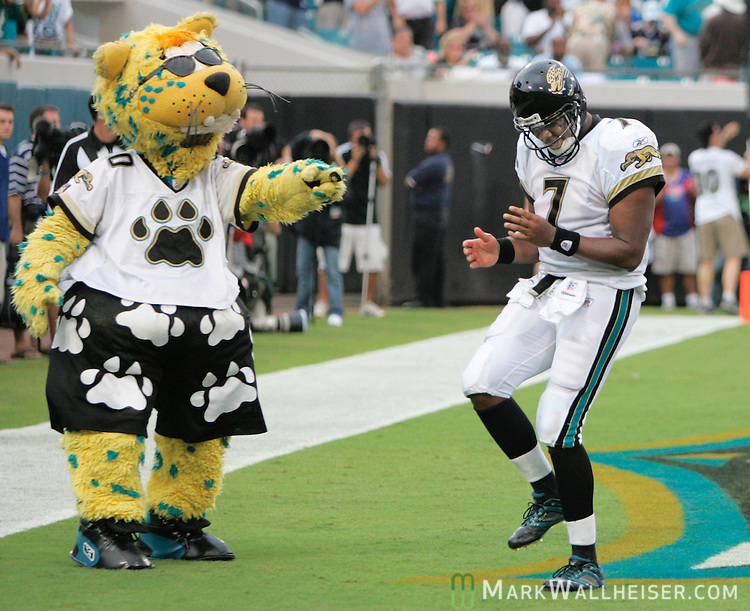 Jacksonville Jaguars mascot Jaxon DeVille (L) points at quarterback Byron Leftwich as he dances in the end zone after running for a touchdown in the Jaguars 24-17 win over the Dallas Cowboys in their NFL game at Alltel Stadium in Jacksonville, Florida September 10, 2006.