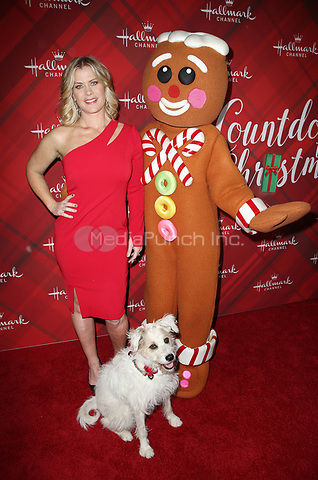 LOS ANGELES, CA - DECEMBER 4: Alison Sweeney, Happy the Dog, Gingerbread man figure, at Screening Of Hallmark Channel's 'Christmas At Holly Lodge' at The Grove in Los Angeles, California on December 4, 2017. Credit: Faye Sadou/MediaPunch