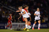 Portland Thorns midfielder Allie Long (10) passes the ball under pressure from Western New York Flash midfielder Carli Lloyd (10). The Portland Thorns defeated the Western New York Flash 2-0 during the National Women's Soccer League (NWSL) finals at Sahlen's Stadium in Rochester, NY, on August 31, 2013.