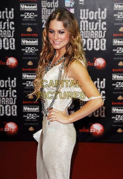 LOLA PONCE.At the World Music Awards in Monte Carlo, Monaco, 9th November 2008..arrivals red carpet Half length white dress hand on hip necklaces off the shoulder .CAP/TTL .©TTL/Capital Pictures