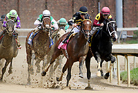 LOUISVILLE, KY - MAY 06: Wild Shot #8 (black cap), ridden by Corey Lanerie, leads the field out of the fourth turn and wins the Pat Day Mile Stakes on Kentucky Derby Day at Churchill Downs on May 6, 2017 in Louisville, Kentucky. (Photo by Mary Meek/Eclipse Sportswire/Getty Images)