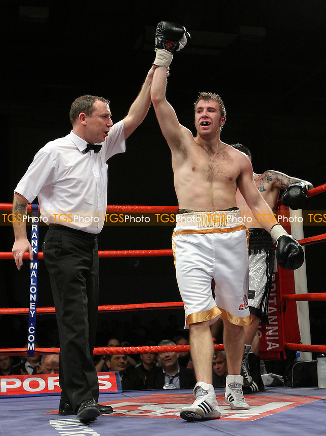 Scott Woolford (Ramsgate, white/gold shorts) defeats David Ryan (Derby, white/black shorts) in a Welterweight contest at Newham Leisure Centre, promoted by Frank Maloney - 30/11/07 - MANDATORY CREDIT: Gavin Ellis/TGSPHOTO. Self-Billing applies where appropriate. NO UNPAID USE. Tel: 0845 094 6026