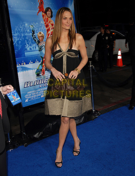 "MOLLY SIMS.Attends The Paramount Pictures L.A. Premiere of ""Blades of Glory"" held at The Graumann's Chinese Theatre in Hollywood, California, USA. .March 28th, 2007.full length black dress gold trim brown bag purse  .CAP/DVS.©Debbie VanStory/Capital Pictures"