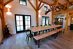 The dining room area is part of the main open living area on the first floor of the home of Steve and Jennifer Schatz. The open-concept home is designed to resemble a Missouri dairy barn. <br /> Photo by Tim Vizer