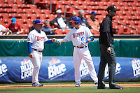 Buffalo Bisons second baseman Andy Burns (8) fist bumps manager Gary Allenson (5) with umpire Eric Gillam to the right during a game against the Toledo Mudhens on May 18, 2016 at Coca-Cola Field in Buffalo, New York.  Buffalo defeated Toledo 7-5.  (Mike Janes/Four Seam Images)