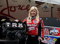 Feb 8, 2014; Pomona, CA, USA; NHRA funny car driver Courtney Force poses for a portrait during qualifying for the Winternationals at Auto Club Raceway at Pomona. Mandatory Credit: Mark J. Rebilas-