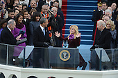 President Barack Obama greets singer Kelly Clarkson following a vocal selection after sworn-in for a second term as the President of the United States by Supreme Court Chief Justice John Roberts during his public inauguration ceremony at the U.S. Capitol Building in Washington, D.C. on January 21, 2013.    .Credit: Pat Benic / Pool via CNP