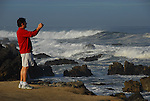 Man photographing the Pacific