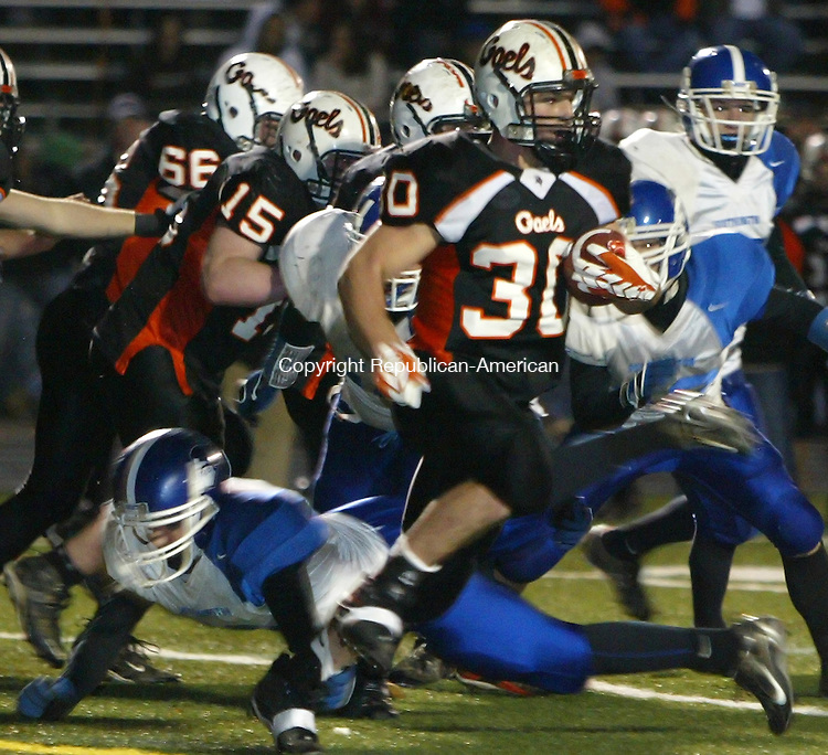 Shelton, CT-27 November 2007-112707MK11 Shelton's #30 Geoffrey Schultz rushes through the line during CIAC Class LL semifinal playoffs against Southington Tuesday night at Shelton High School.   Michael Kabelka / Republican-American   ( Shelton's #30 Geoffrey Schultz)CQ