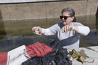 NWA Democrat-Gazette/FLIP PUTTHOFF<br /> SPRING CREEK CLEANING<br /> Debby Corwin picks up litter on Wednesday March 14 2018 during a cleanup of Spring Creek in the area of downtown Springdale. Dozens of volunteers waded the creek and shoreline to spruce up the creek. Washington County Environmental Affairs, Downtown Springdale Alliance and University of Arkansas Extension Service teamed up to host the event. Volunteers included community residents, scouts and Tyson Foods employees who were allowed to leave work early to help.