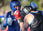 Nevada's Garrett Felling, left, and Air Force's Laurynas Galdikas compete in an intercollegiate boxing match at TJ's Corral at Carson Valley Inn, in Minden, Nev., on Saturday, Sept. 13, 2014. Felling won on a TKO.<br /> Photo by Cathleen Allison