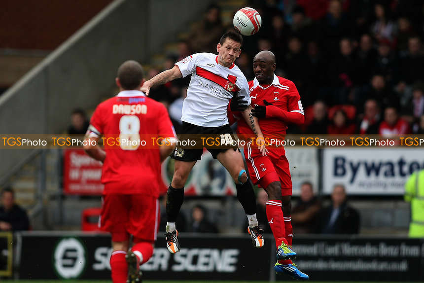 Charlie Macdonald (MK Dons) heads from Terrell Forbes (Leyton Orient) - Leyton Orient vs MK Dons - nPower League One Football at the Matchroom Stadium, Brisbane Road, London - 26/12/11 - MANDATORY CREDIT: George Phillipou/TGSPHOTO - Self billing applies where appropriate - 0845 094 6026 - contact@tgsphoto.co.uk - NO UNPAID USE.
