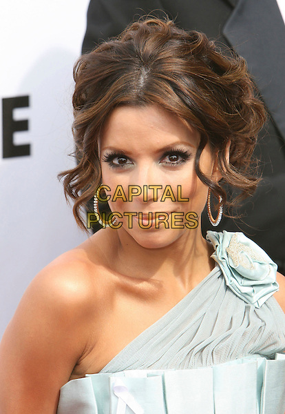EVA LONGORIA.2007 NCLR ALMA Awards - Arrivals held at the Pasadena Civic Center, Pasadena, California, USA, 01 June 2007..portrait headshot diamond hoop earrings grey pale blue flower corsage on one shoulder.CAP/ADM/CH.©Charles Harris/AdMedia/Capital Pictures. *** Local Caption *** .