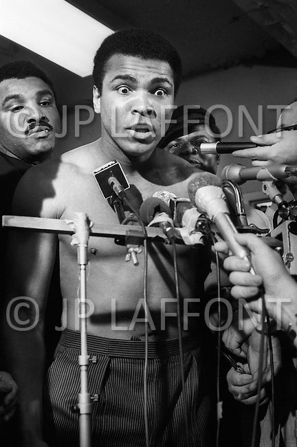 Jan 23, 1974, New York CIty, New York - Madison Square Garden: Just before the second match revenge, Ali beat Frazier this time. Ali on the weighing scale before his revenge match.