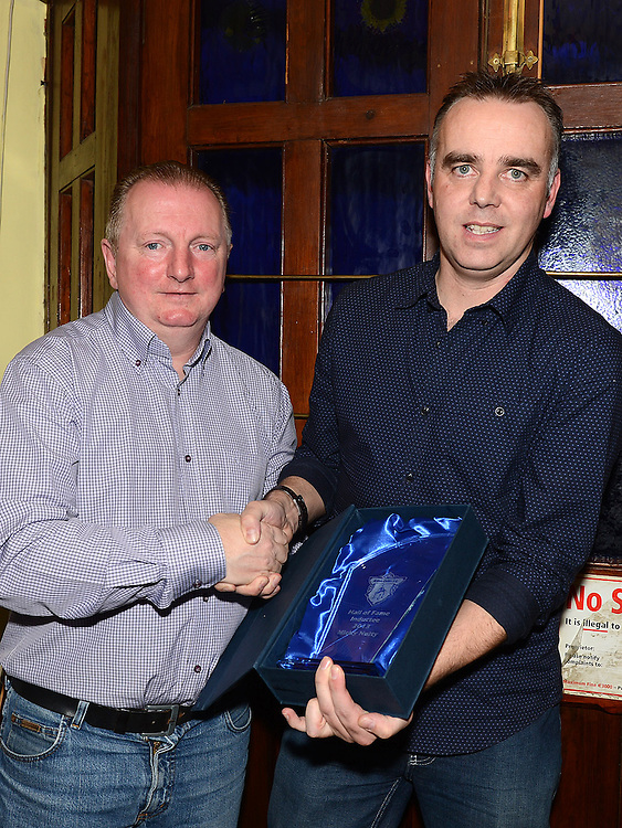 Adrian Taaffe presents tht Hall of Fame award to Mickey Nulty at the Ardee Celtic awards night in Butterly's Bar. Photo:Colin Bell/pressphotos.ie