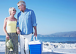 USA, California, Fairfax, Happy mature couple standing on beach