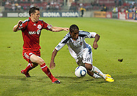 26 June 2010:  Los Angeles Galaxy defender Alex Cazumba #88 and Toronto FC defender Dan Gargan #8 in action during a game between the Los Angeles Galaxy and the Toronto FC at BMO Field in Toronto..Final score was 0-0...