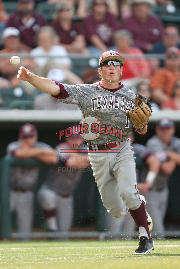 Texas A&M Aggies third baseman Blake Allemand #1 throws to first in the ninth inning of the NCAA baseball game against the Texas Longhorns on April 29, 2012 at UFCU Disch-Falk Field in Austin, Texas. The Longhorns beat the Aggies 2-1 in the last ever regular season game scheduled for the long time rivals. (Andrew Woolley / Four Seam Images)