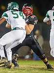San Pedro, CA 11/27/15 - James Rawls (Mira Costa #54) and Jack Murphy (Palos Verdes #70) in action during the CIF Western Division semi-final game between Mira Costa and Palos Verdes.  Palos Verdes defeated Mira Costa to advance to the Western Division finals.