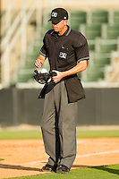 Home plate umpire Mike Patterson during the South Atlantic League game between the Lexington Legends and the Kannapolis Intimidators at CMC-Northeast Stadium on May 20, 2012 in Kannapolis, North Carolina.  The Legends defeated the Intimidators 7-1.  (Brian Westerholt/Four Seam Images)