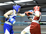 Adam Farrell (in blue) from Ardee boxing Club and Josh Murphy from Mullingar Boxing Club in action in the Louth Meath Boxing Championships held in Holy Family Boxing Club Ballsgrove.  Photo:Colin Bell/pressphotos.ie