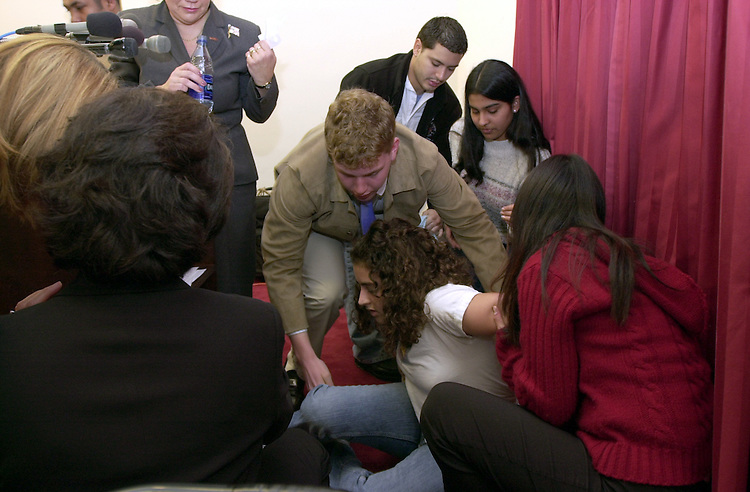 10madd032102 -- A student from a Montgomery Co. high school fainted and was helped out of the room by Michah Behrend, 17, who was one of the speakers at the press conference in the Rayburn building Thursday morning.  The press conference was held by MADD to encourage NBC and other advertisers and media outlets, to encourage alcohol advertisers to gear their ads toward a more mature audience, not underage drinkers.
